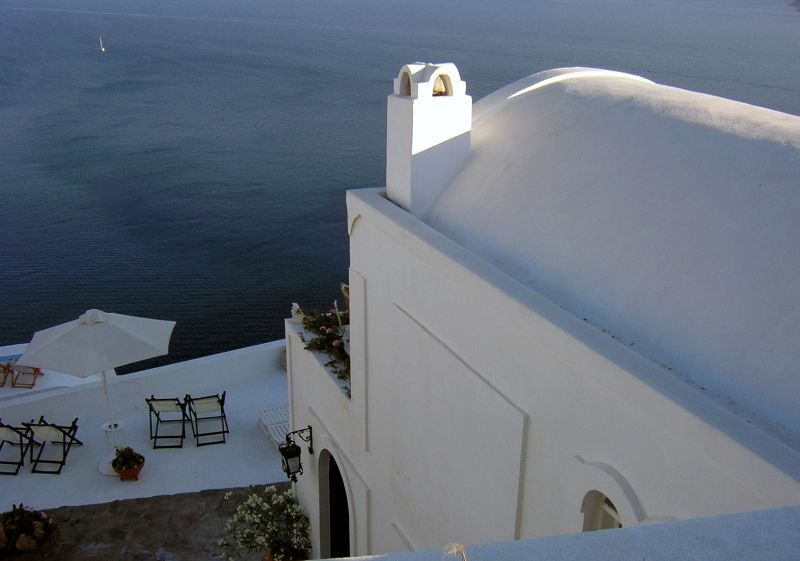 Greece in Summer - Image of Santorini Balconies by the sea