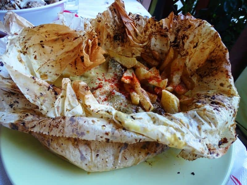pork cooked in greeseproof paper from Synantisi taverna in Kissos