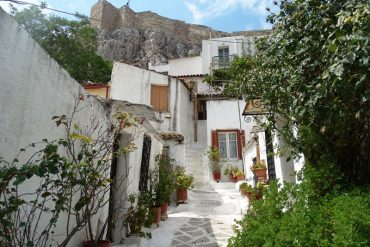 an alleyway in Anafiotika with the Acropolis at the top