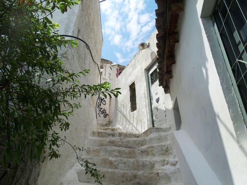 climbing the stairs in Anafiotika