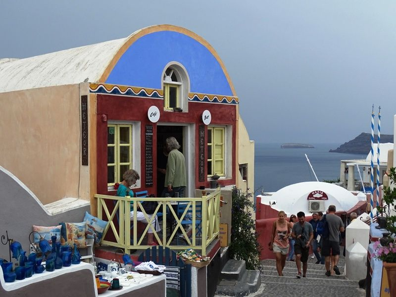 Colorful cafe in Oia
