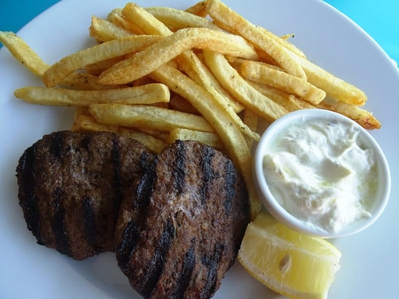 grilled burgers with homemade fries and tzatziki sauce