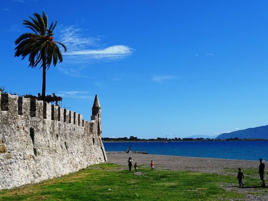 the beach by the fortifications of the castle - nafpaktos