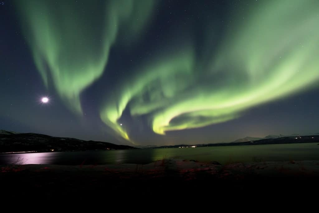 Aurora borealis (Polar lights) over the mountains in the North of Europe - Narvik