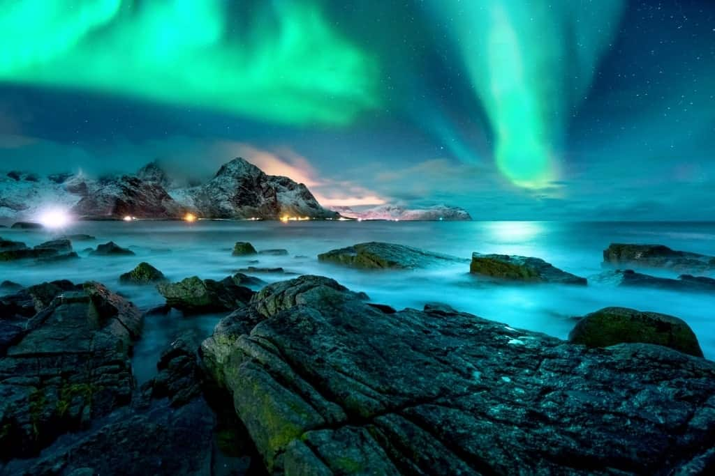 Aurora borealis above snowy islands of Lofoten