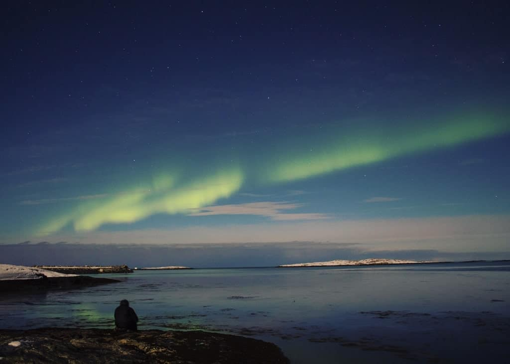 Northern lights from the beach at Mjelle Beach in Northern Norway - Best place to see the Northern lights in Norway