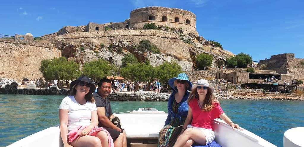 arriving in Spinalonga by boat